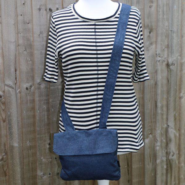 Crossbody handbag in denim with navy polka dot lining