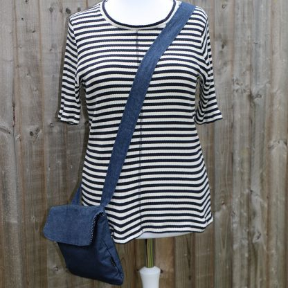 Crossbody handbag in denim with navy polka dot lining