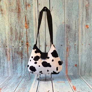 Hobo Style Handbag in Cow Print Faux Fur with Black Cotton Lining