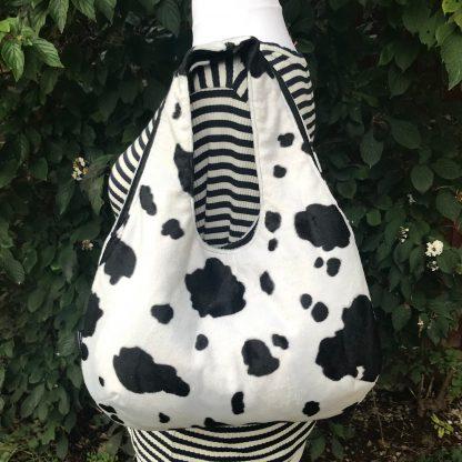 Large Hobo Round handbag in Cow Print Faux Fur