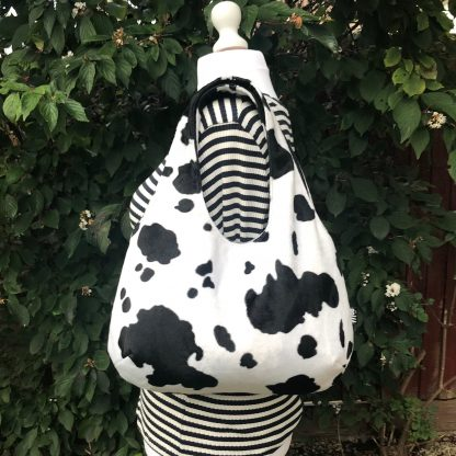 Large Hobo Round handbag in Cow Print Faux Fur
