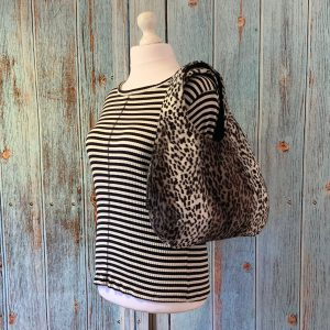 Large Hobo Round handbag in Snow Leopard Print Faux Fur